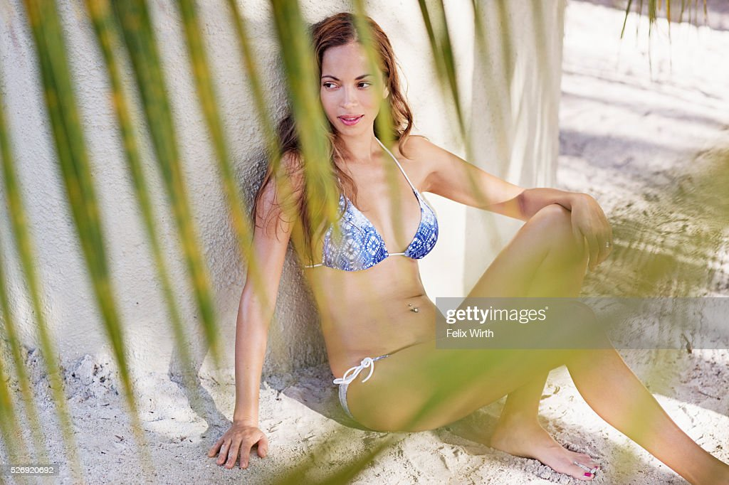Young woman in bikini resting on beach : Stock Photo