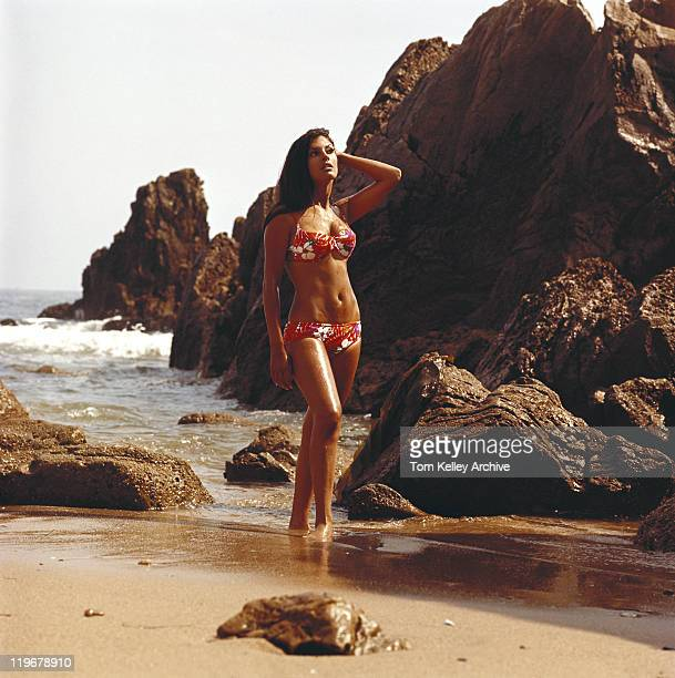 Young woman in bikini standing on beach
