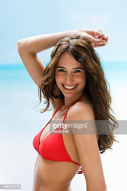 Young woman in bikini top laughing