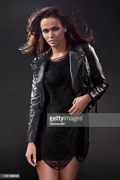 Young woman in black dress and leather jacket, portrait