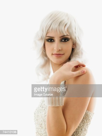 Young woman in blonde wig : Stock Photo