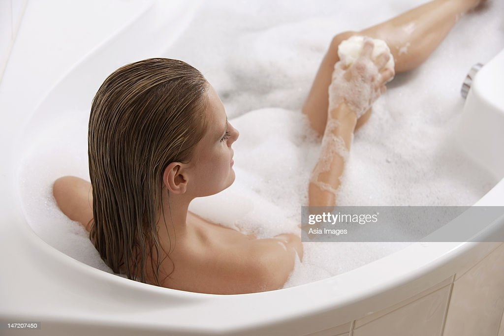 Young woman in bubble bath : Stock Photo