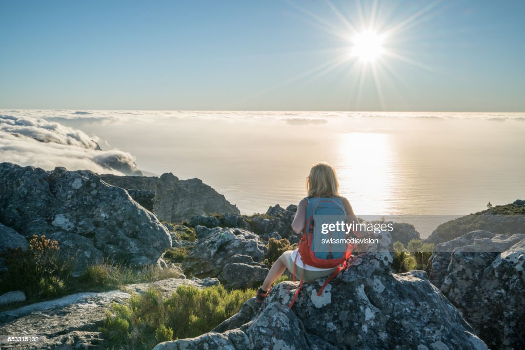 Young woman in Cape Town on top of mountain looking at view : Stock Photo