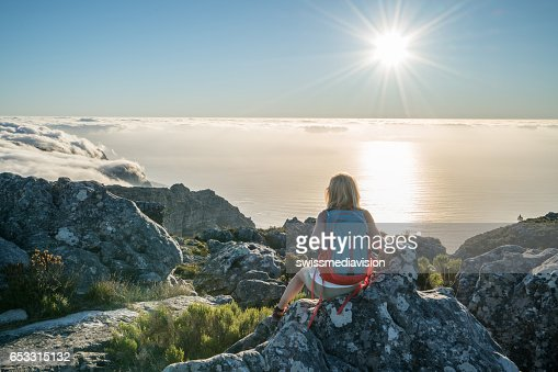 Young woman in Cape Town on top of mountain looking at view : Photo