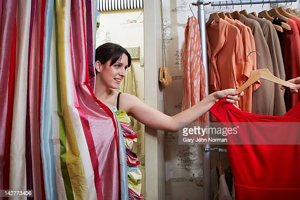 Young woman in changing room of boutique shop