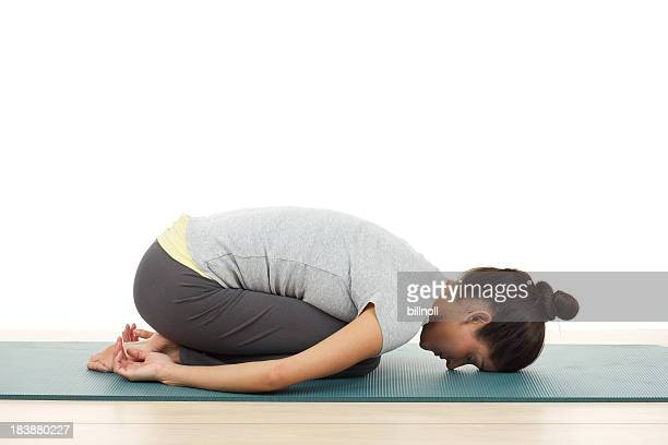 Young woman in child's pose yoga position