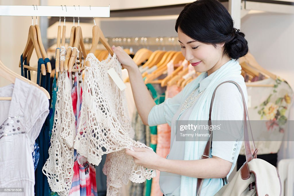 Young woman in clothing shop : Stock Photo