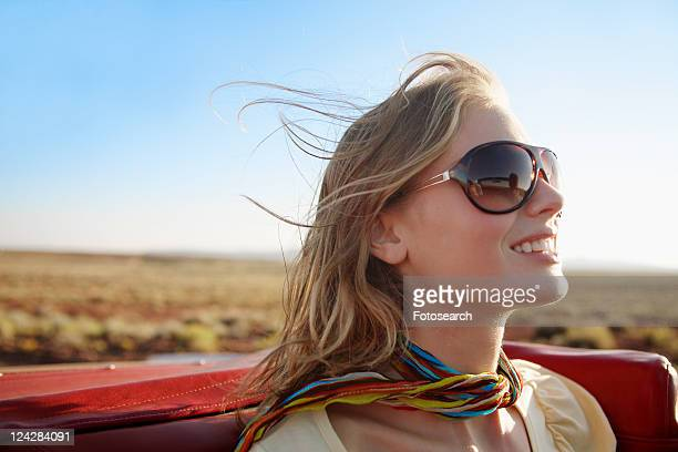 Young woman in convertible
