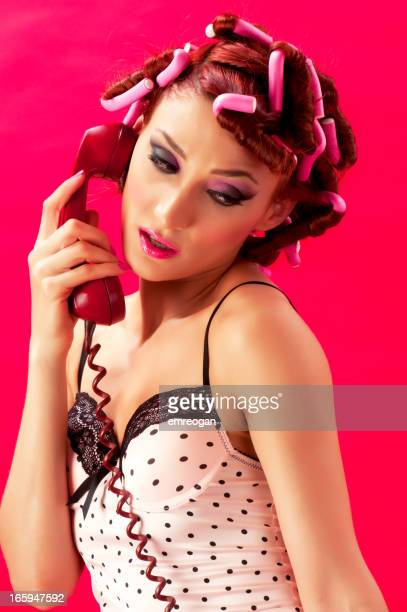 Young woman in curlers