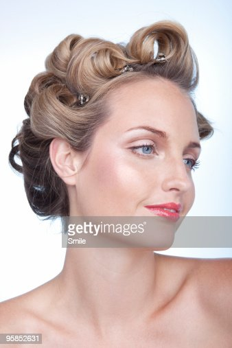 Young woman in curlers : Stock Photo
