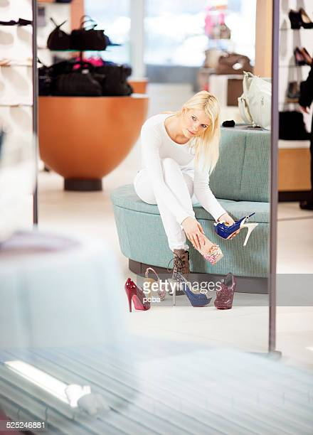 young woman  in department store looking at new shoes