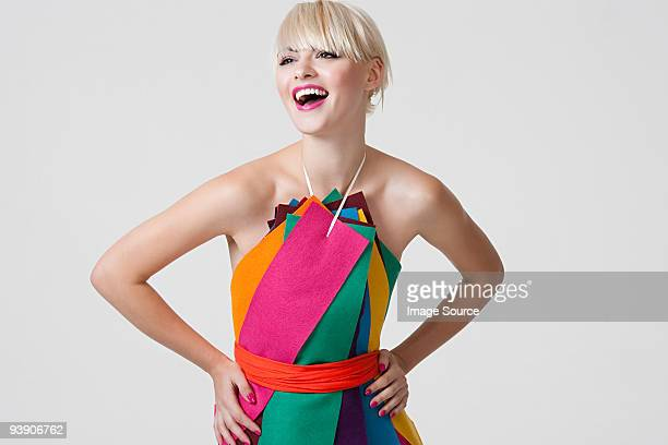 Young woman in dress made of coloured ribbons