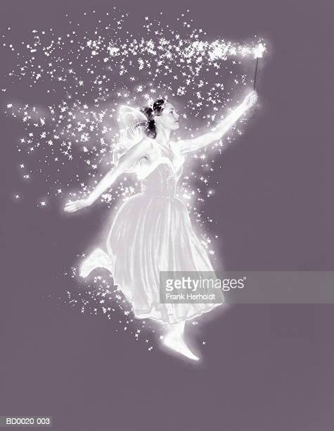 Young woman in fairy costume, wand emitting sparkles (Enhancement)