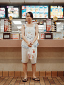 Young woman in fast food restaurant