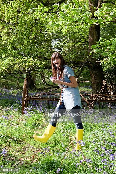 Young woman in field of bluebells