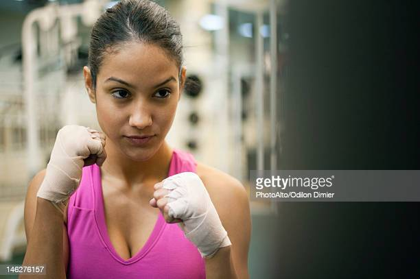 Young woman in fighting stance