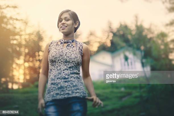 Young woman in fresh air at dusk.