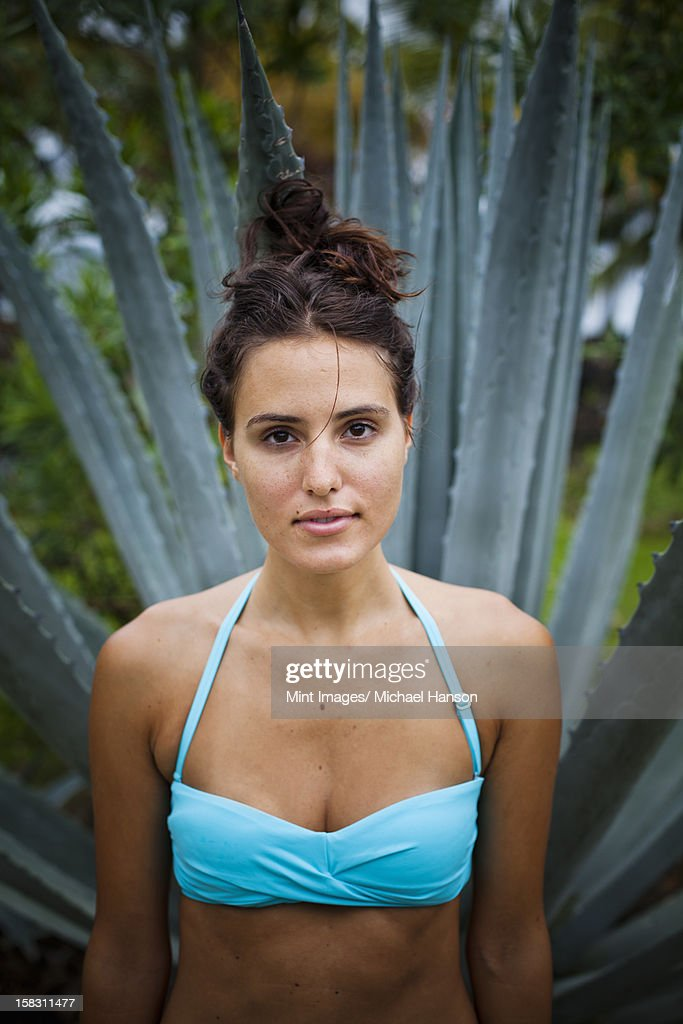 Young woman in front of an agave plant in Las Galeras, Samana Peninsula, Dominican Republic. : Stock Photo