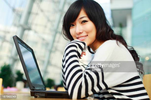 young woman in front of laptop