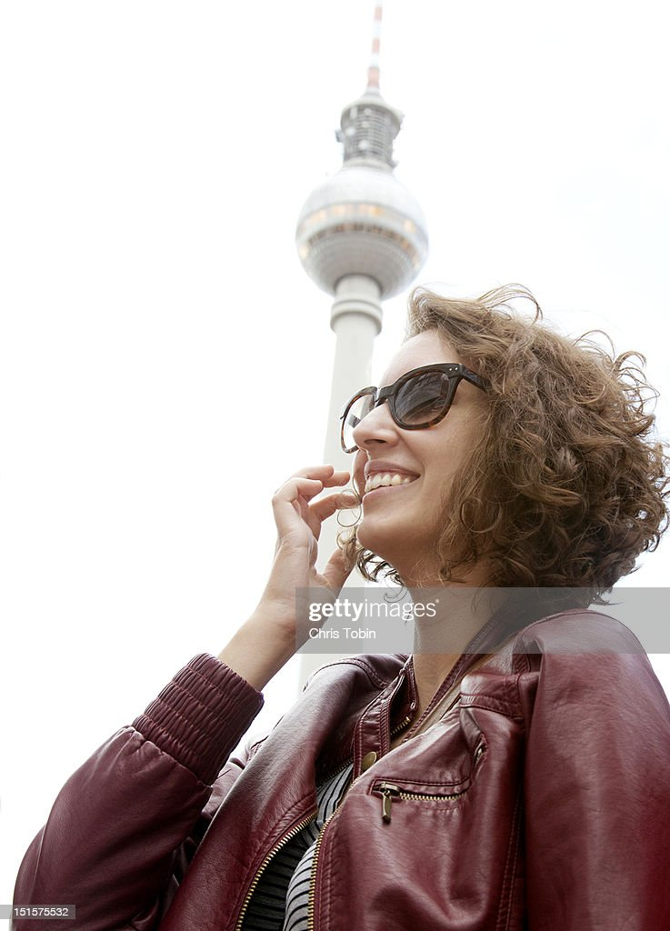Young woman in front of the Berlin TV tower : Stock Photo