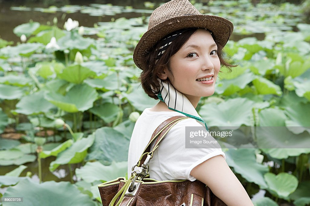 Young woman in garden : Stock Photo