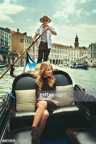 Young woman in gondola tour in Venice