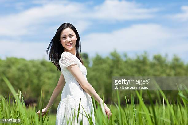 Young woman in grass area