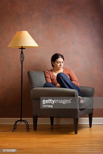 Young Woman in Green Chair