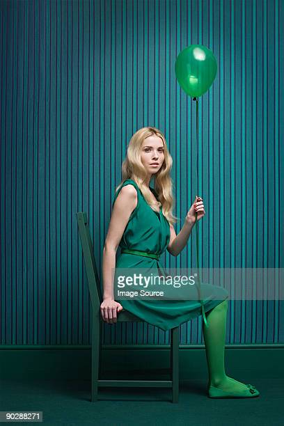 Young woman in green with balloon