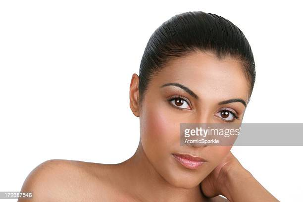 Young woman in heavy natural makeup against white