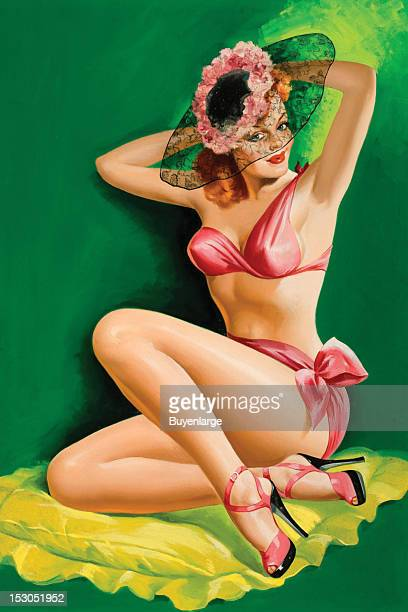 Young woman in high heels two piece bathing suit fixes her hat which is gossamer with a floral pink wreath 1949 By Peter Driben