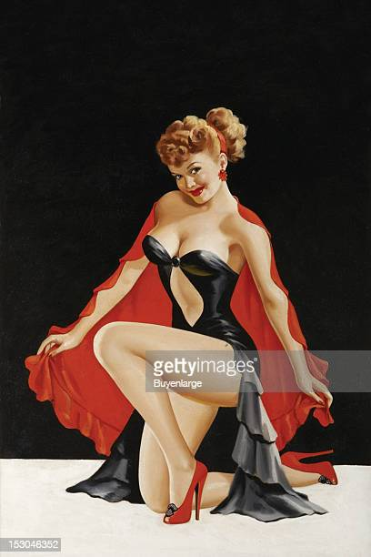 Young woman in high heels two piece suit kneeling late 1940s By Peter Driben