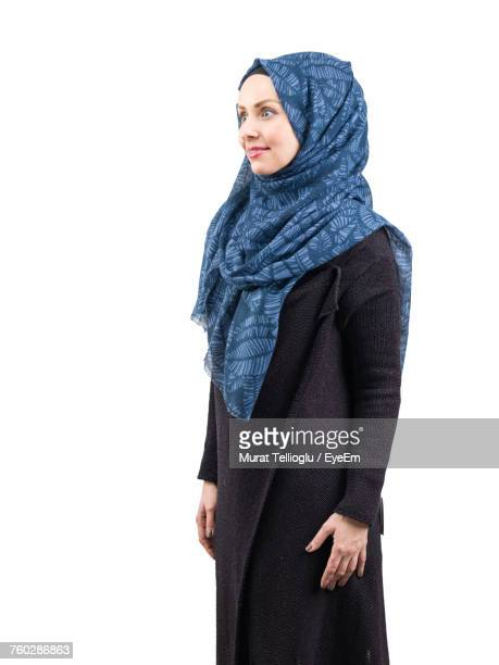 Young Woman In Hijab Standing Against White Background