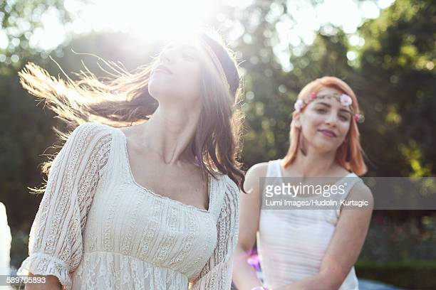 Young woman in hippie style fashion flicking her hair