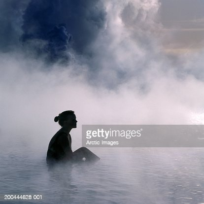 Young woman in hot spring, side view