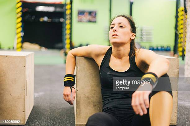 Young woman in intensity training sesion tired and resting.