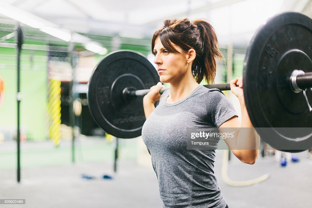 Young woman in intensity training session.