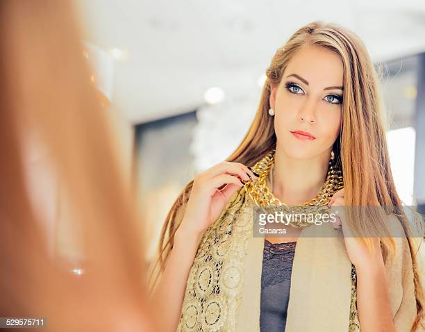 Young woman in jewelry shop