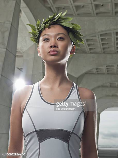 Young woman in laurel wreath