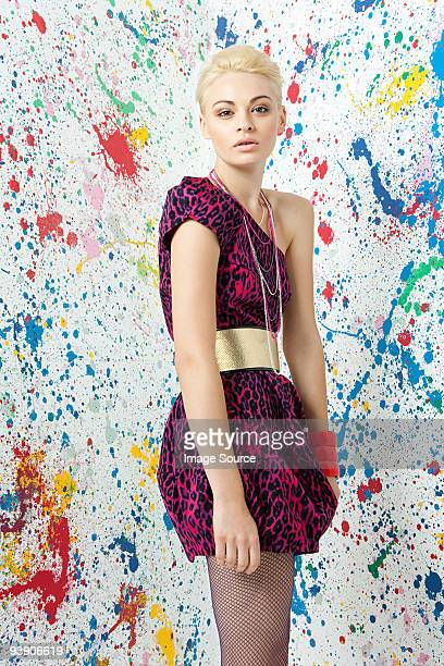 Young woman in leopard print dress