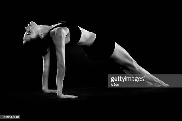 Young woman in leotard practicing yoga,