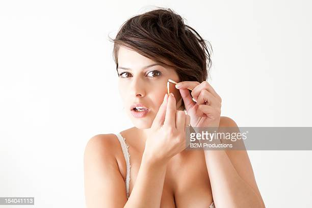 Young Woman In Lingerie Getting Beauty Treatment