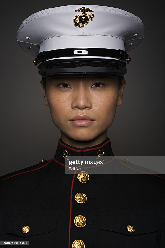 Young woman in military uniform, close-up, portrait