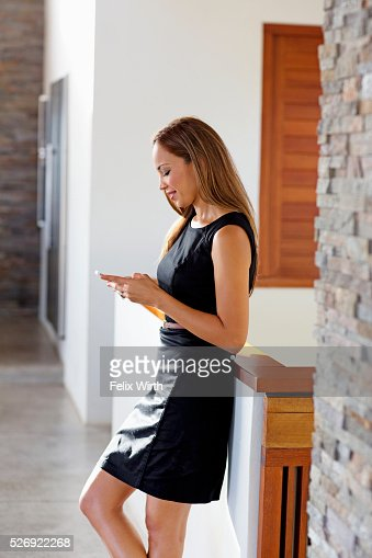 Young woman in modern home : Stock Photo