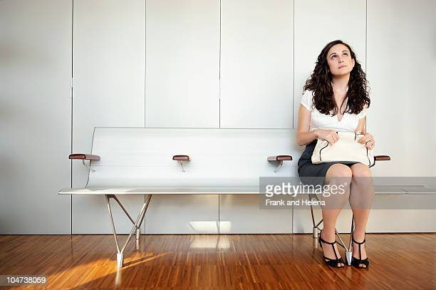 Young woman in modern waiting room