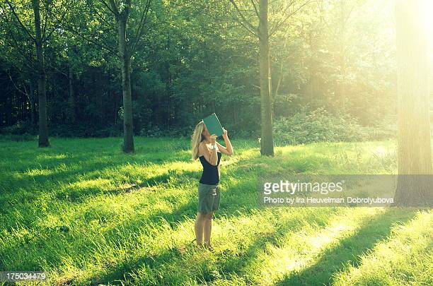 Young woman in morning light in woods