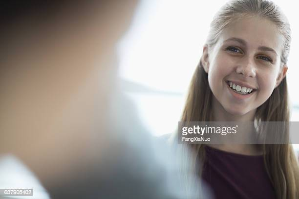 Young woman in office business meeting