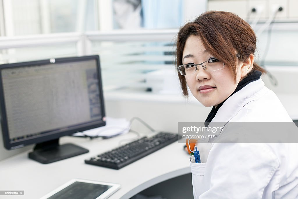 Young woman in office : Stock Photo