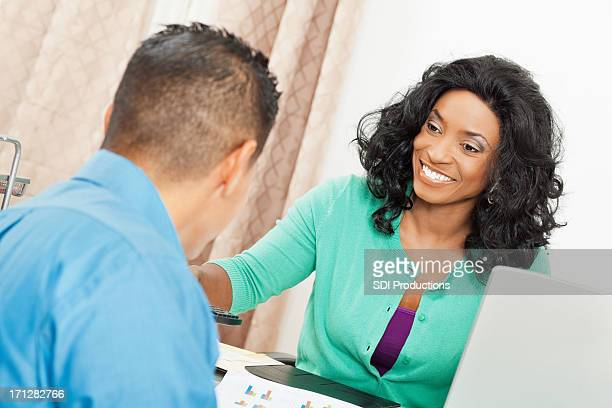 Young woman in office with client or colleague