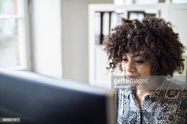 Young woman in office working at computer